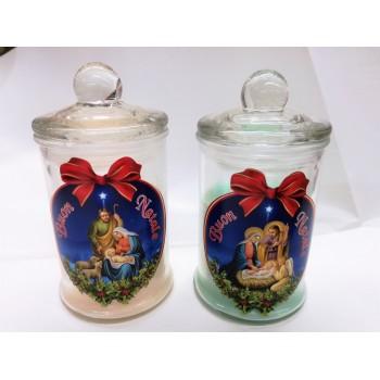 Candela profumata colorata in vasetto vetro con natività